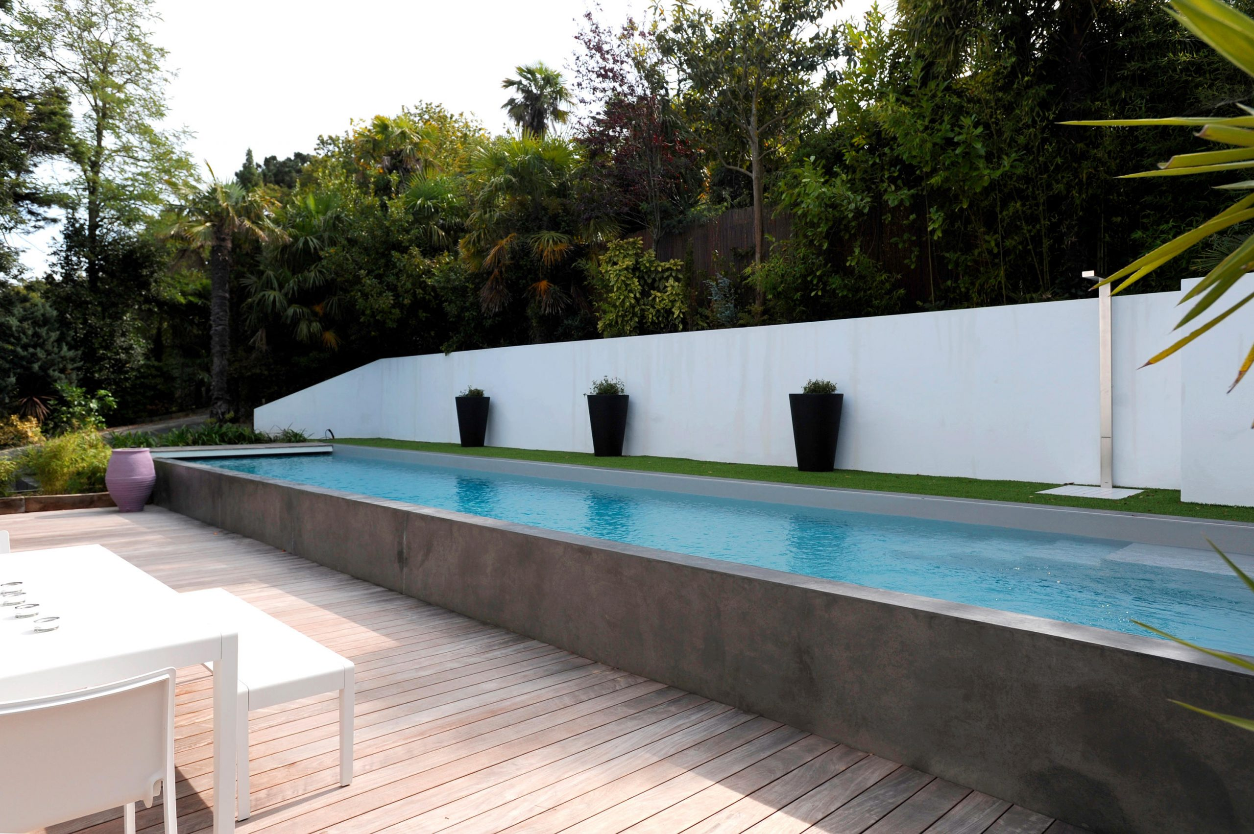 Half Burried Pool & Designer Furniture | Architonic encequiconcerne Piscine Semi Enterrée Beton